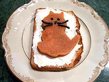 Quince paste kitty on cream cheese.
